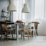 Dining room in industrial style with table and metal rack